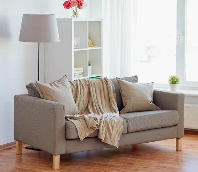 sofa with cushions at cozy home living room PZL6Z8J